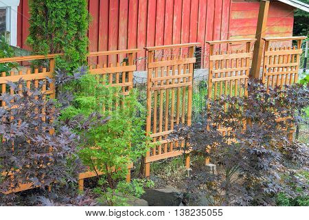 Craftman Style Wood Trellis and trees to cover farm red barn animals fencing in garden backyard