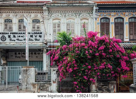 GEORGE TOWN MALAYSIA - MARCH 22: Facade of the old shophouse building in UNESCO Heritage buffer zone in George Town Penang Malaysia on March 22 2016.