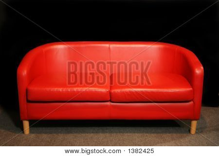Retro Red Sofa In Dark Room