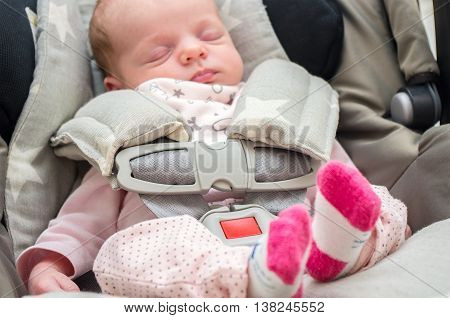 Newborn Baby Girl In A Car Seat