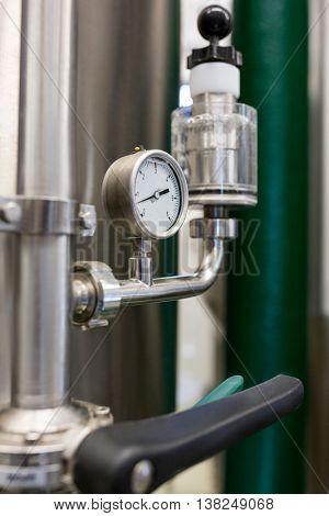 Close-up of barometer at bewery