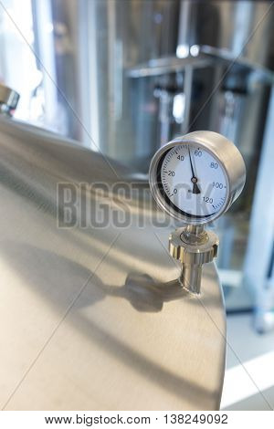 Close-up of barometer on distillery at brewery
