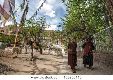 LADAKH INDIA - MAY 14 : An unidentified tibetan Buddhist devotee in front of the Alchi monastery in May 14 2016 in Ladakh India. Alchi is one of the oldest Tibetan monasteries in Ladakh.