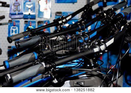 Row of multicolored bicycle handlebars. Sport bikes.