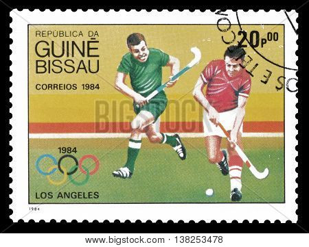GUINEA BISSAU - CIRCA 1984 : Cancelled postage stamp printed by Guinea Bissau, that shows Field hockey.