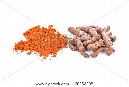 Turmeric rhizome and powder on white background