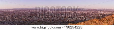 Panoramic image of The Valley of the Sun Phoenix metropolitan area. Phoenix is the capitol of Arizona USA and it's downtown is visible in the middle section of the image.