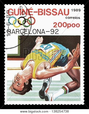 GUINEA BISSAU - CIRCA 1989 : Cancelled postage stamp printed by Guinea Bissau, that shows High jump.