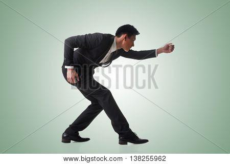 Asian business man posing tug of war, full length portrait isolated