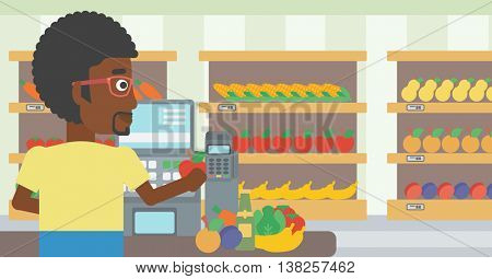 An african-american young male cashier standing at the checkout in supermarket. Male cashier working at checkout in supermarket. Vector flat design illustration. Horizontal layout.
