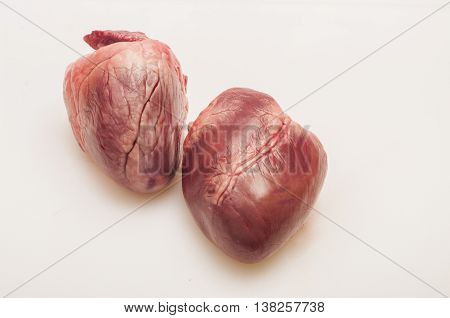 Pig heart on a white background close up