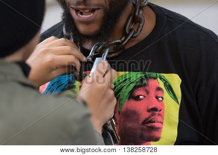 Black Lives Matter Protestor Wearing A Chain With Lock Around His Neck On City Hall