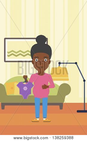 An african-american pregnant woman holding clothes for her baby. Pregnant woman with bodysuit for baby. Pregnant woman with presents at baby shower. Vector flat design illustration. Vertical layout.