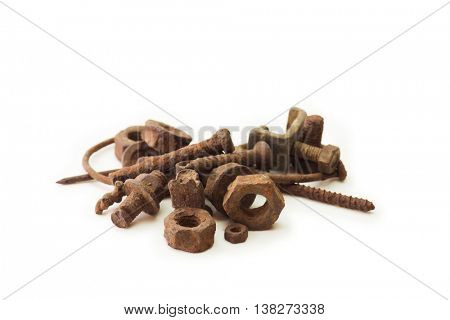 Heavily rusted nuts and bolts, screws and nails, isolated on white.