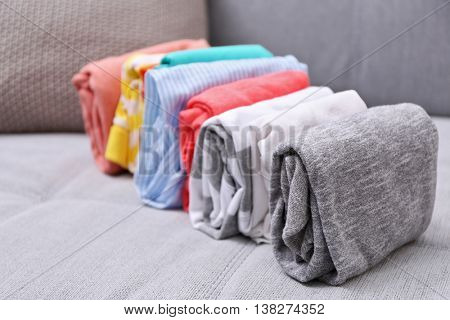 Stack of clothes on couch