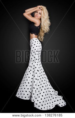 Beautiful Blond With Long Curly Hair Young Woman In The White Model Black Ball Gown, A Polka Color W