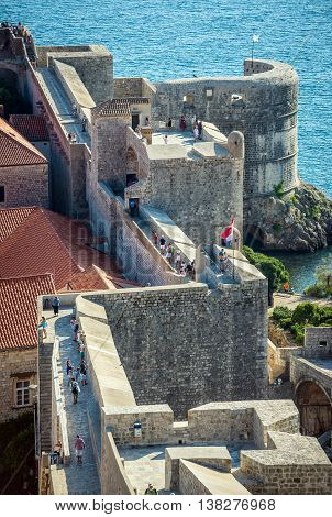 Dubrovnik Croatia - August 26 2015. Tourists walks on the Walls of Dubrovnik. View with Fort Bokar