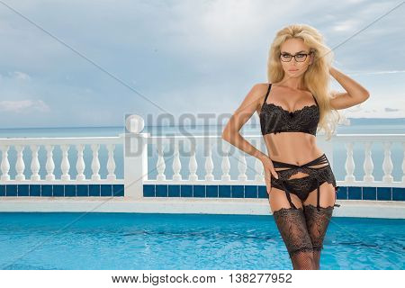 Beautiful Blond Hair Sexy Woman Young Girl Model In Sunglasses And Elegant Black Sexy Swimsuit Linge