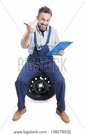 Attractive Mechanic On Tire Showing Middle Finger