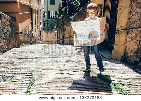 Young tourist with city map stay on the old italian street