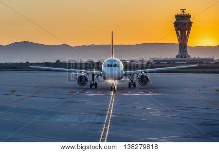 Barcelona Spain - May 28 2015. Airplane on runway of Barcelona El Prat International Airport