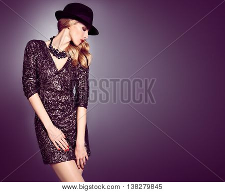 Fashion woman in Glamour Sequin black dress. Stylish Luxury Party lady. Blond sexy Model girl, Fashion hat, Trendy glamour Hairstyle. Fashion Makeup, shiny fashion Accessories. Unusual creative Outfit