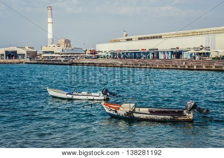 Tel Aviv Israel - October 18 2015. Small wooden boats in Tel Aviv Port area. View with Reading Power Station