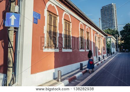 Tel Aviv Israel - October 20 2015. Small house and modern residential skyscraper on background in historic Neve Tzedek district (lit. Abode of Justice) in southwestern part of Tel Aviv