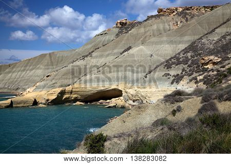 A secluded bay in Malta showing the geology of the Island