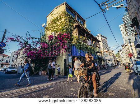 Tel Aviv Israel - October 20 2015. People at the Shalom Shabazi street in historic Neve Tzedek district (lit. Abode of Justice) of Tel Aviv