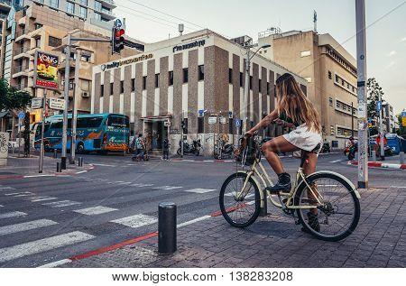 Tel Aviv Israel - October 20 2015. Woman rides bike at Rothschild Boulevard in Tel Aviv