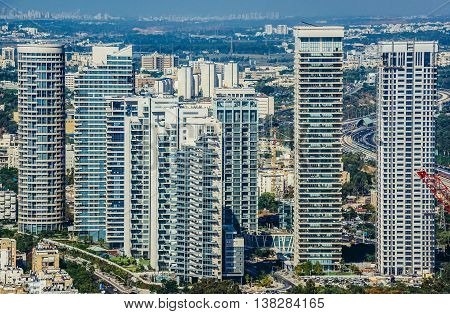 Tel Aviv Israel - October 21 2015. Aerial view from 49th floor of Circular Tower one of three skyscrapers of Azrieli Center complex in Tel Aviv. Residential buildings of Park Tzameret on photo