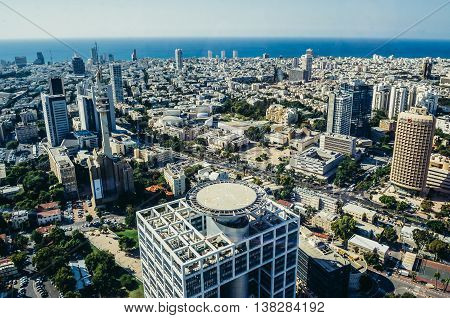 Tel Aviv Israel - October 21 2015. Aerial view from 49th floor of Circular Tower one of three skyscrapers of Azrieli Center complex in Tel Aviv. Matcal Tower on foreground