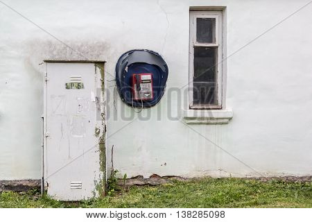 Public payphone on the wall with window