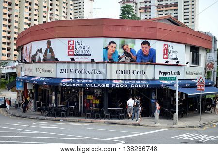 SINGAPORE- 10 JULY 2016: Street view of Holland Village in Singapore. Holland Village is a popular shopping and dining destination for younger Singaporeans and expatriates.