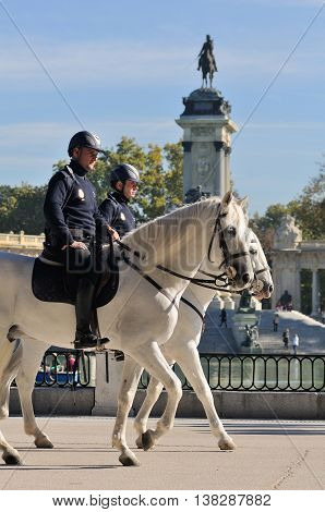 MADRID, SPAIN - OCTOBER 26: Police riders in Buen Retiro park on October 26, 2010 in Madrid, Spain. Buen Retiro park is the largest park of the city of Madrid.