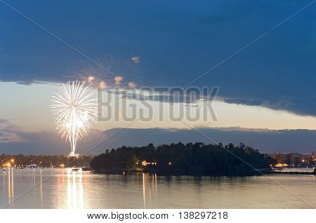 fourth of july fireworks display during celebration on steamboat bay of east gull lake near brainerd minnesota