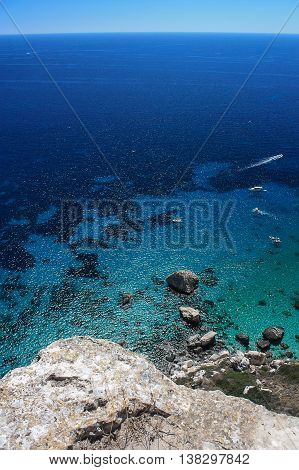 Sea view from the mountains on the transparent sea water and sea floor. Location La Sella del Diavolo - The Devil*s Saddle in Cagliari, Sardinia, Italy.