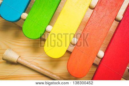 bright multi coloured children's wooden xylophone toy