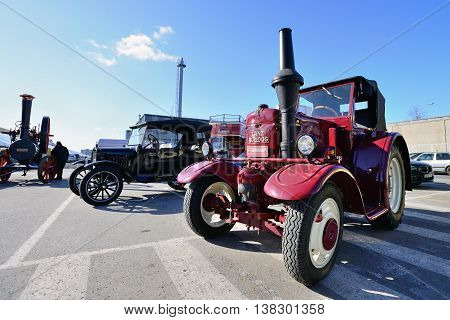 KAUNAS, LITHUANIA - MAR 23: Vintage tractor in antique car show in a traditional flea market in second biggest Lithuanian city - Kaunas, on March 23, 2013 in Kaunas, Lithuania