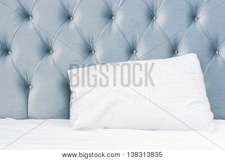 Soft Blue Headboard And White Pillow