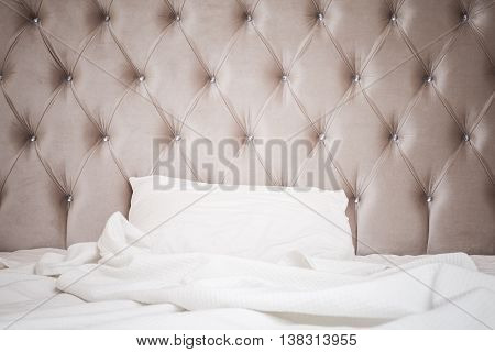 Pink Headboard, White Bedding Sheet And Pillow