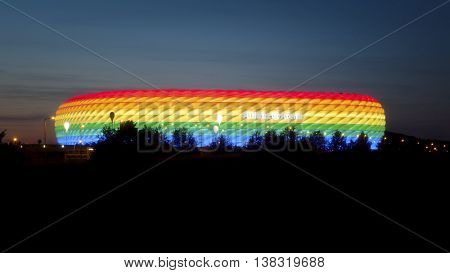 MUNICH, GERMANY - JULY 9, 2016: Long exposure of a highway at night with Allianz Arena, colored in rainbow colors for CSD weekend, Munich, Bavaria, Germany