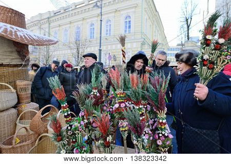 VILNIUS, LITHUANIA - MARCH 2: Unidentified peoples with traditional palm bouquets in annual traditional crafts fair - Kaziuko fair on Mar 2, 2013 in Vilnius, Lithuania.