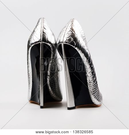 Silver high heels pump shoes in a grey