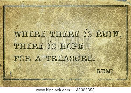 Where there is ruin there is hope for a treasure - ancient Persian poet and philosopher Rumi quote printed on grunge vintage cardboard