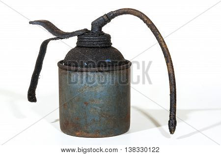 Studio shot of old grungy neglected rusty blue oil can covered in layer of dirt and grime on white