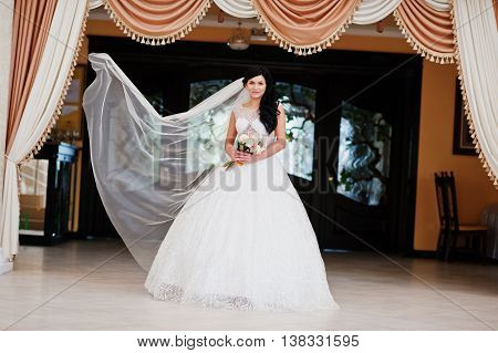 Temptation Model Brunette Bride At Exciting Wedding Dress And Long Veil On Air