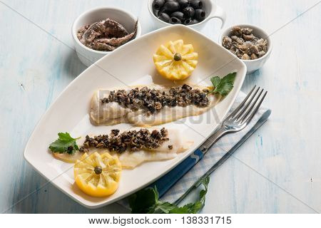 fish fillet with black olives capers and anchovies