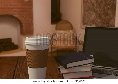 3D rendering of Takeaway coffee laptop and books on a wooden table at home